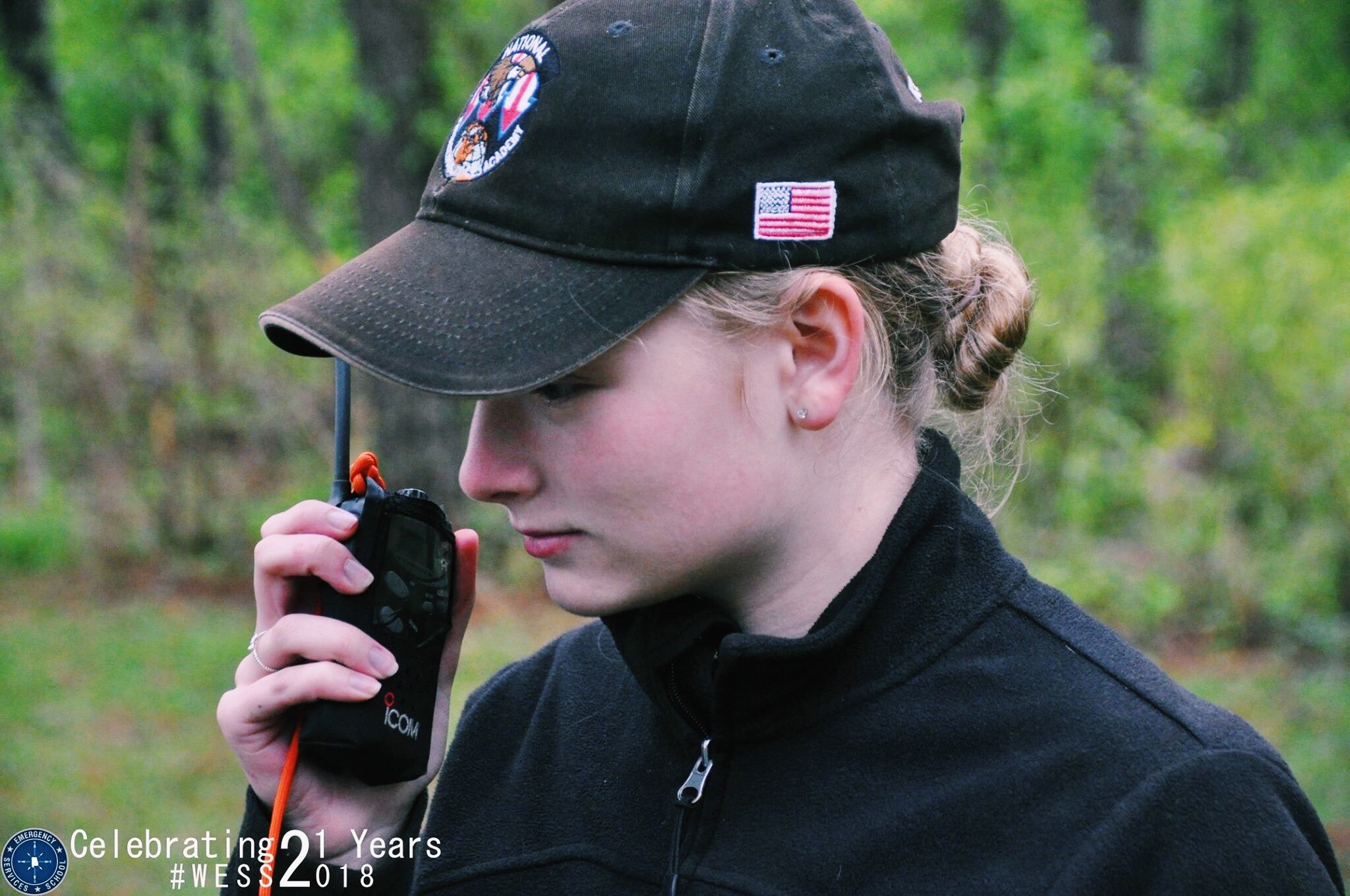 Cadet Colonel Whitney Reuschel speaks on a radio to a ground team in training at the Alabama Wing Emergency Services School.