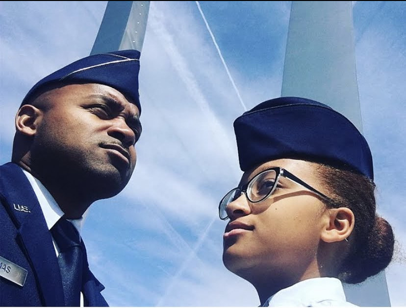 Thomas and her father, a Major in the United States Air Force, visit the Air Force Memorial overlooking the Pentagon.